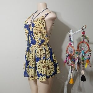 THE CLOTHING COMPANY BACKLESS SUNFLOWER ROMPER!